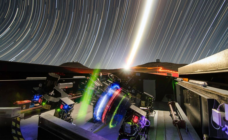 timelapse photo showing the Next-Generation Transit Survey at night, with instruments on