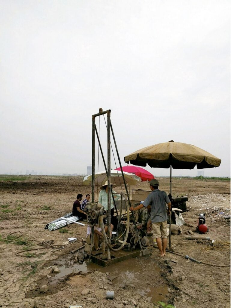Drilling a well for groundwater near Hanoi.