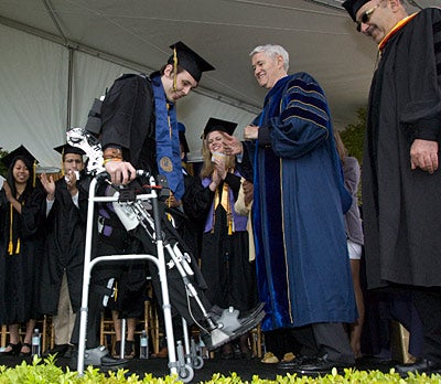 Video: Robotic Exoskeleton Helps Paralyzed College Student Walk Across the Stage at Graduation