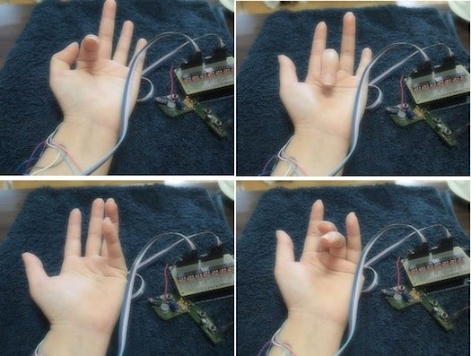 Japanese PossessedHand Electric Wristband Moves Your Fingers For You