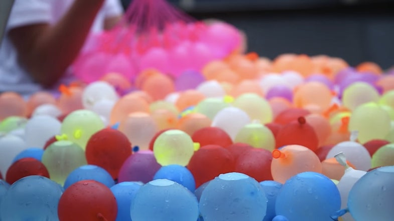 This Is What 1,500 Water Balloons On A Trampoline Looks Like