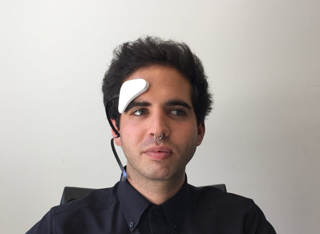 Man with tDCS electrode attached to his forehead.