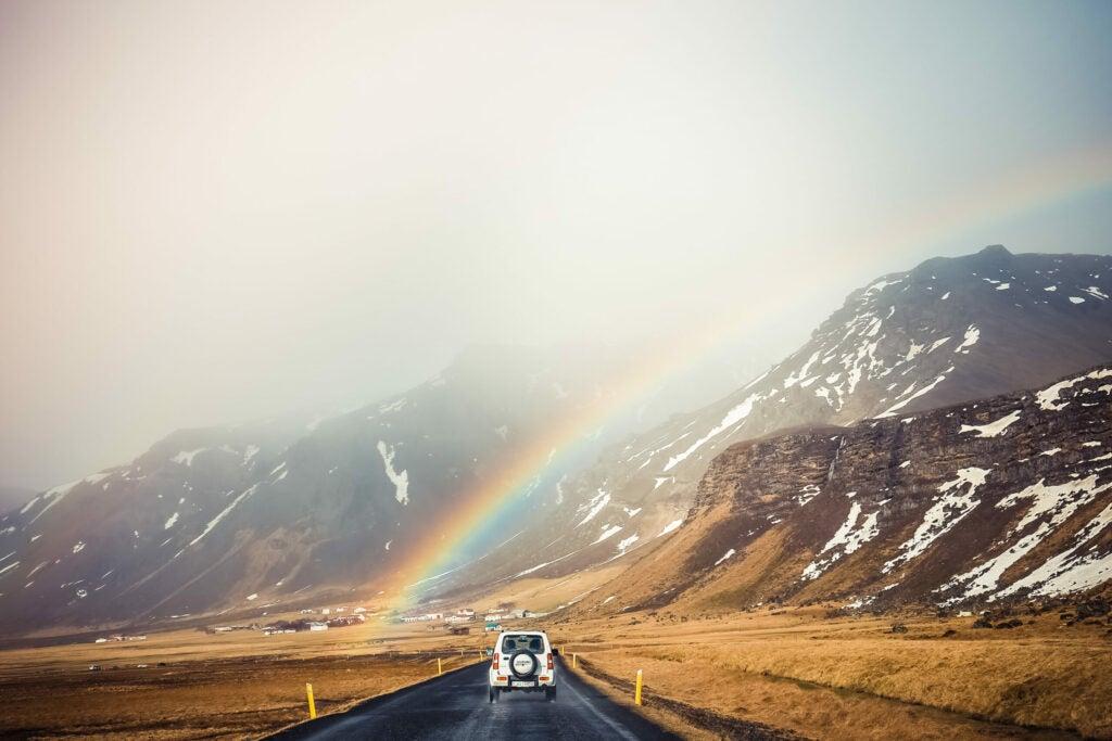 rainbow on a mountain road