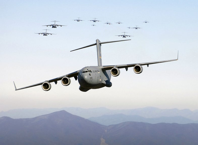Thirteen C-17s flying over the Blue Ridge mountains