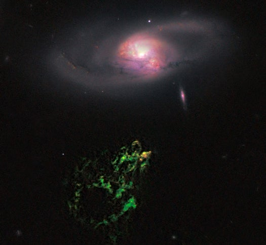 Hubble Zooms in on Hanny's Voorwerp, a Mysteriously Glowing Cloud of Gas