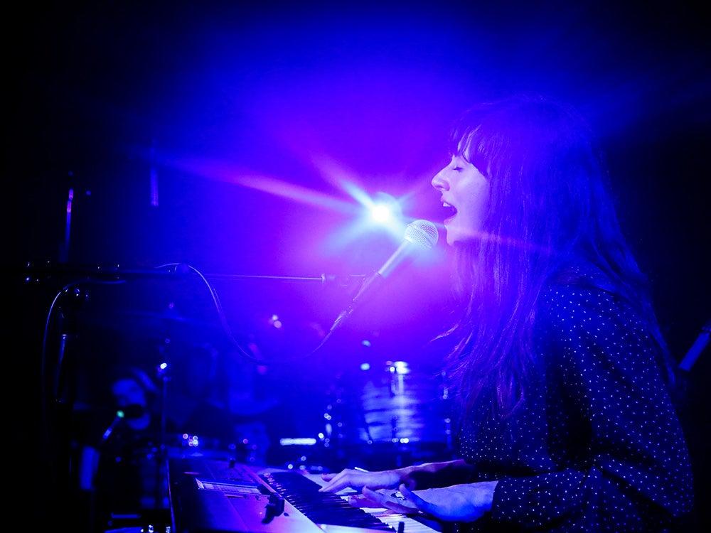 woman singing and playing keyboard