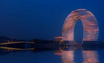 This Mind-Blowing, Horseshoe-Shaped Neon Hotel Can Light Up The Skyline