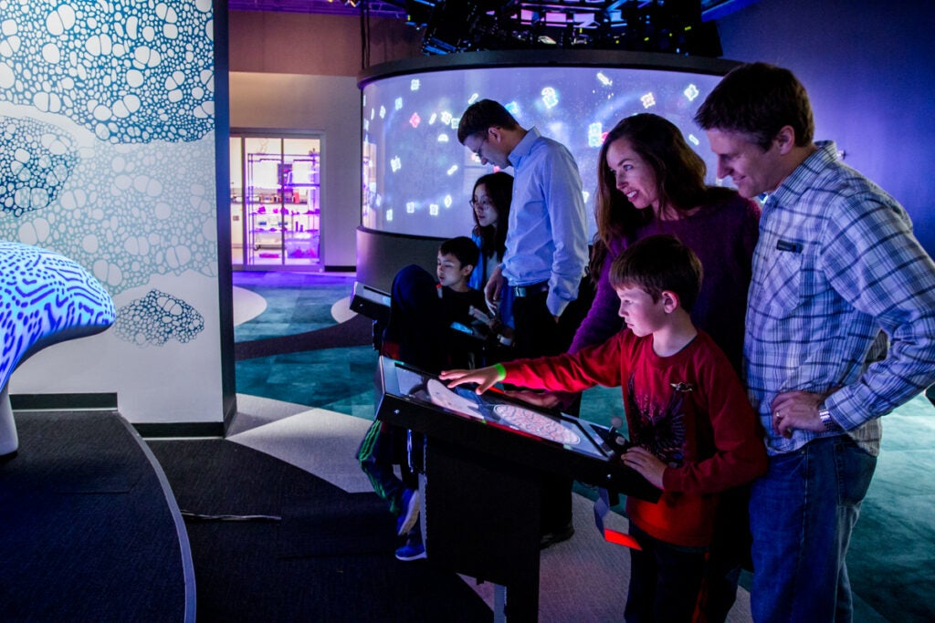 Visitors at The Tech Museum of Innovation's BioDesign Studio.