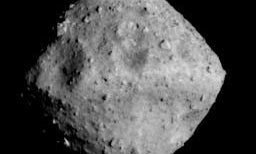 A Japanese spacecraft is zooming towards an asteroid shaped like a gemstone