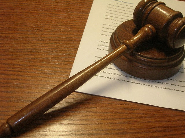 Gavel on op of legal document on table