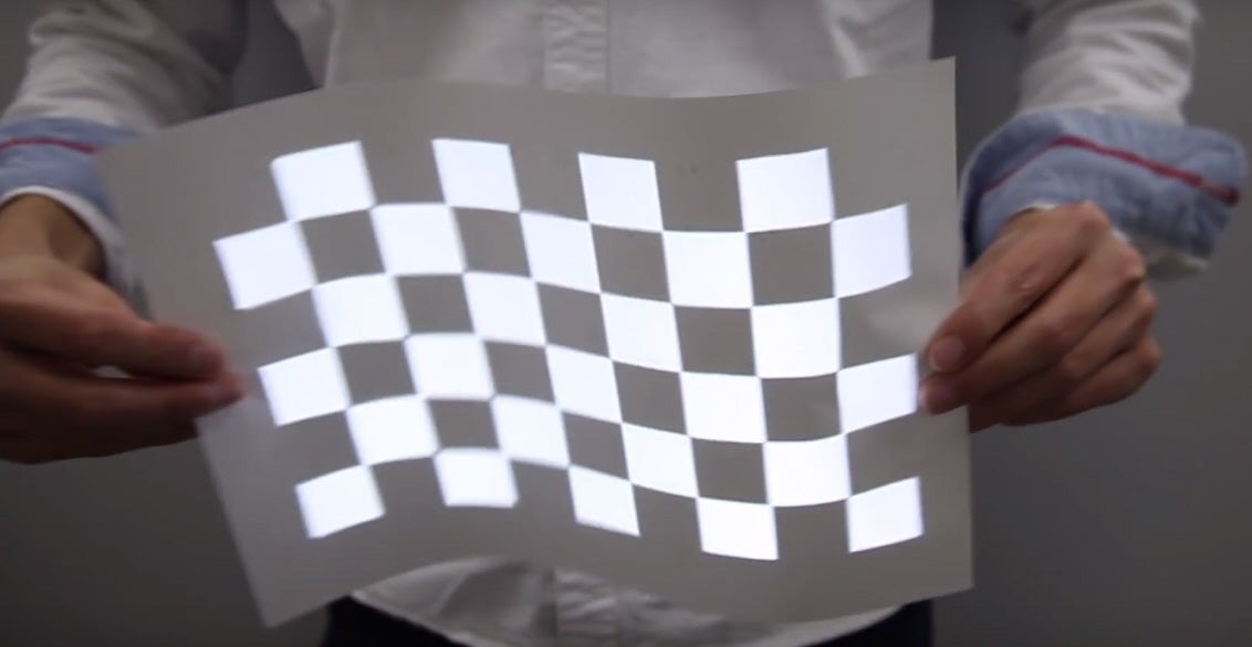 Japanese Projector Displays Smooth Video On A Wriggling, Dancing Surface