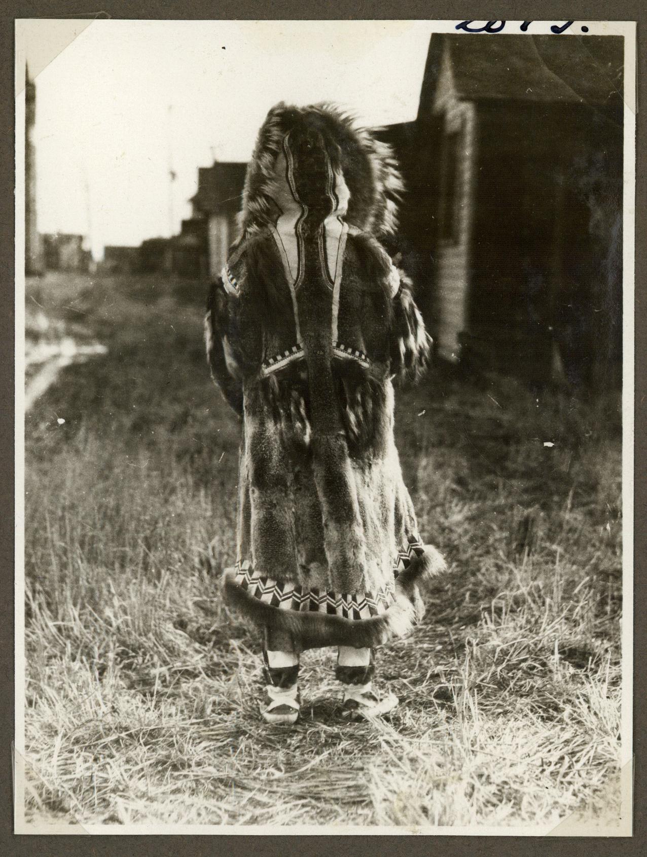 Inuit woman photographed from behind, circa 1921