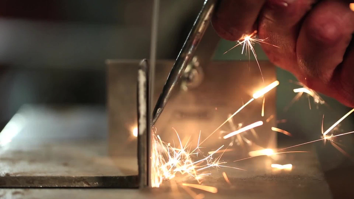 sparks flying from a screwdriver being turned into a chisel
