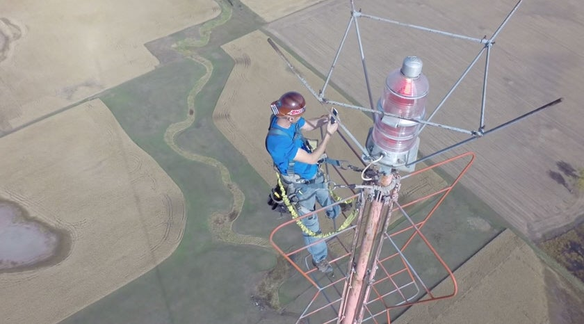 Drone Films Man Changing A Lightbulb 1,500 Feet Above The Ground