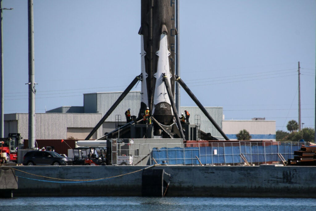 workers at the base of the rocket booster