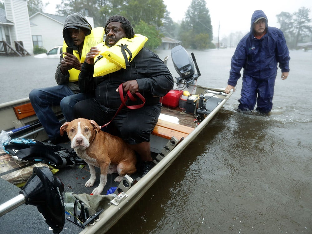 volunteers rescuing residents from flood