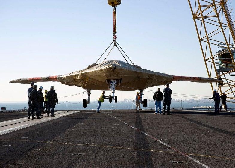 X-47B Hoisted Onto The USS Truman