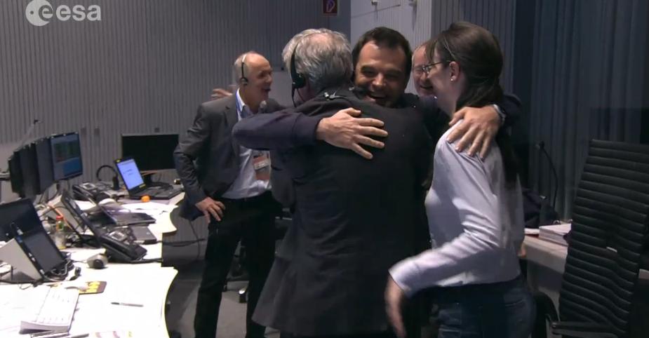 Rosetta mission scientists hug in celebration of Philae's successful landing.