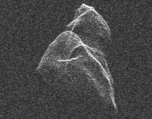 Watch: Asteroid Toutatis Twirling Through Space During Earth Flyby