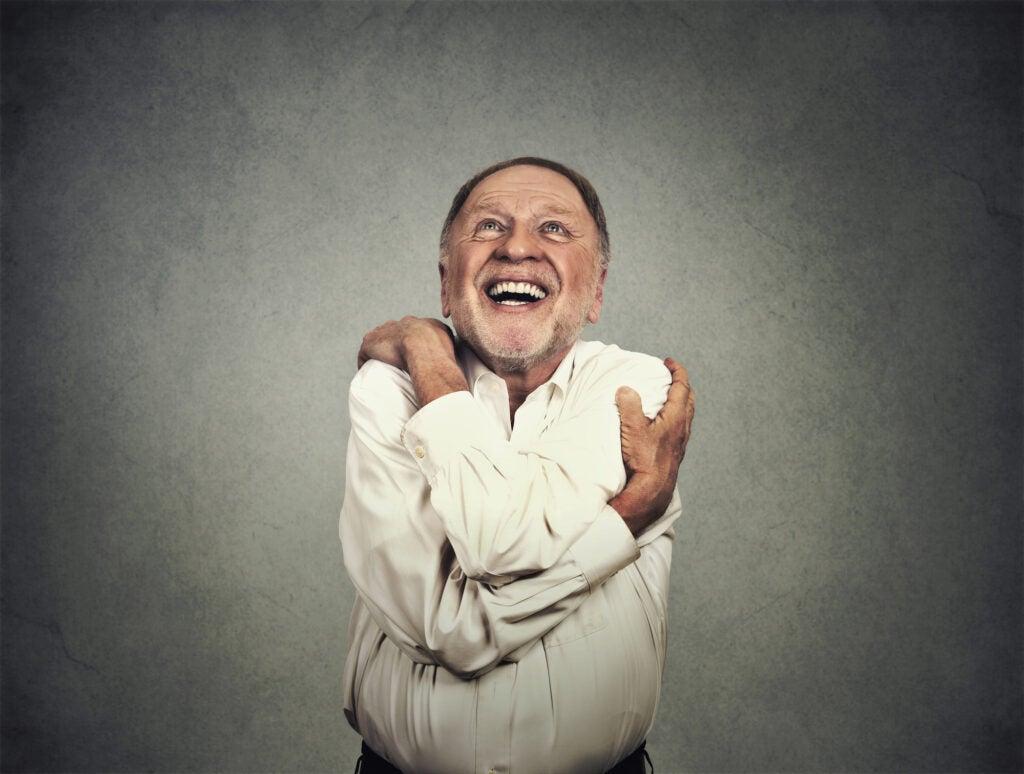 man hugging himself