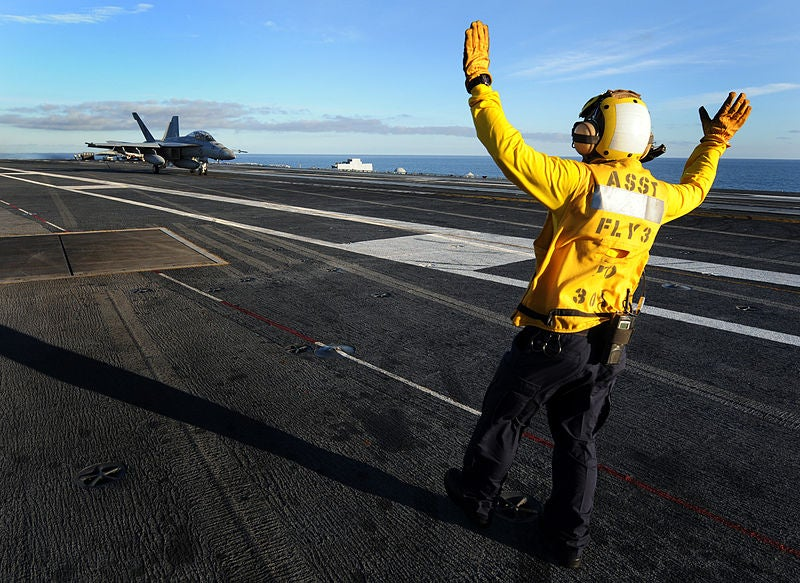 Video: Aircraft Carrier Crews Guide In Robot Planes With Visible Hand Gestures
