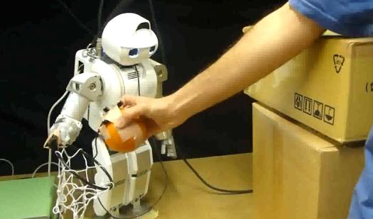 Video: Robot Manipulates Humans' Arms With Electric Stimulation