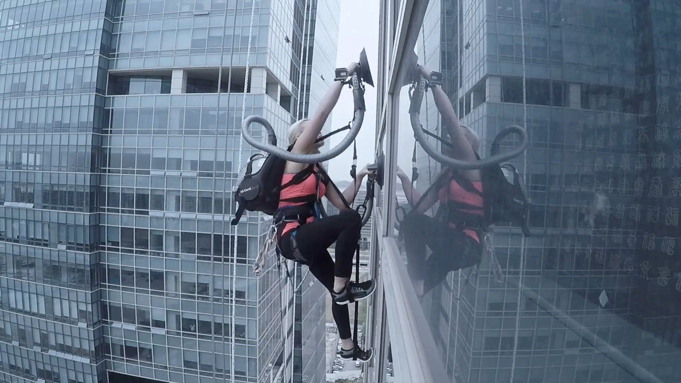 Watch This Woman Climb A Skyscraper With A Vacuum Cleaner