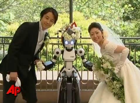 Video: Japanese Robot Officiates Wedding Of Two Humans
