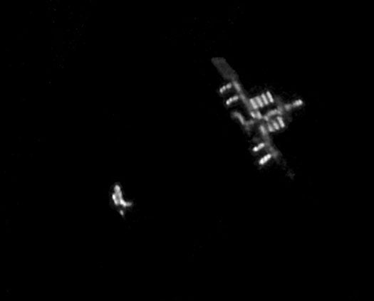 An Amazing Pic of Discovery Docking with the ISS, Taken from Earth