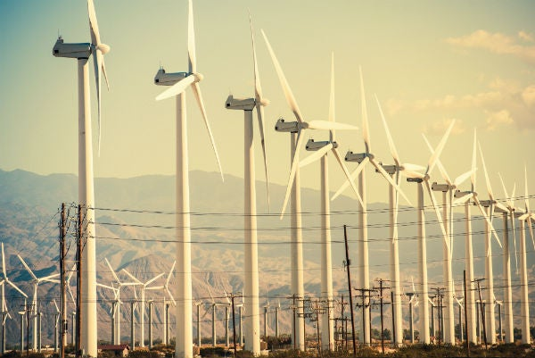 Wind turbines and electric lines.