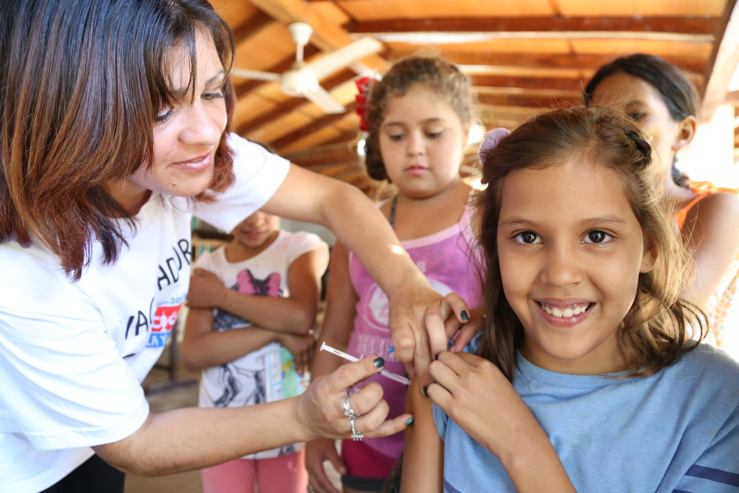 girl getting rubella and measles vaccine in Paraguay