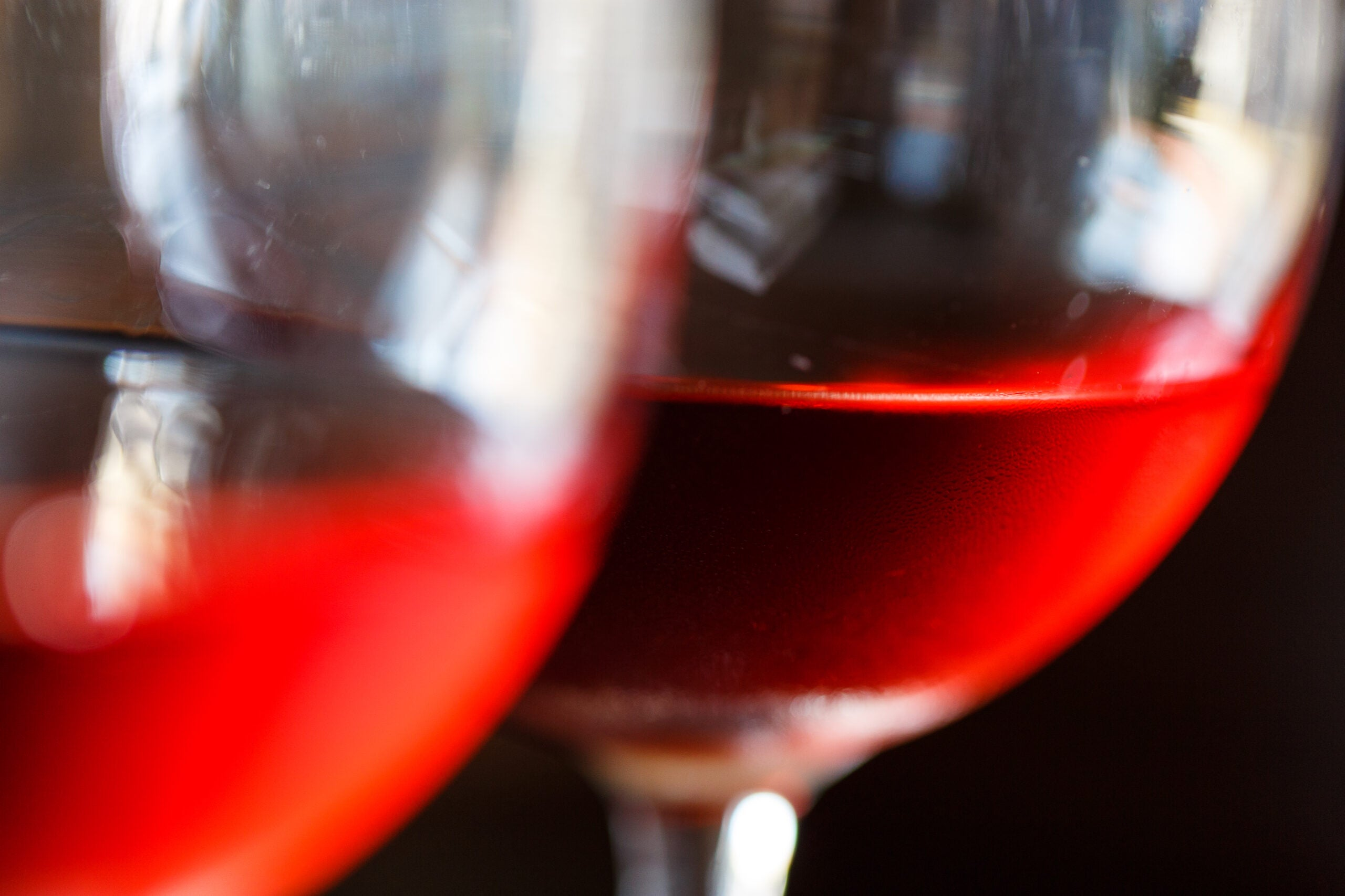 two glasses of red liquid