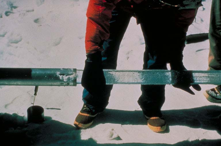 Scientist holding an ice core sample