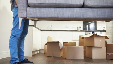 moving in carrying sofa