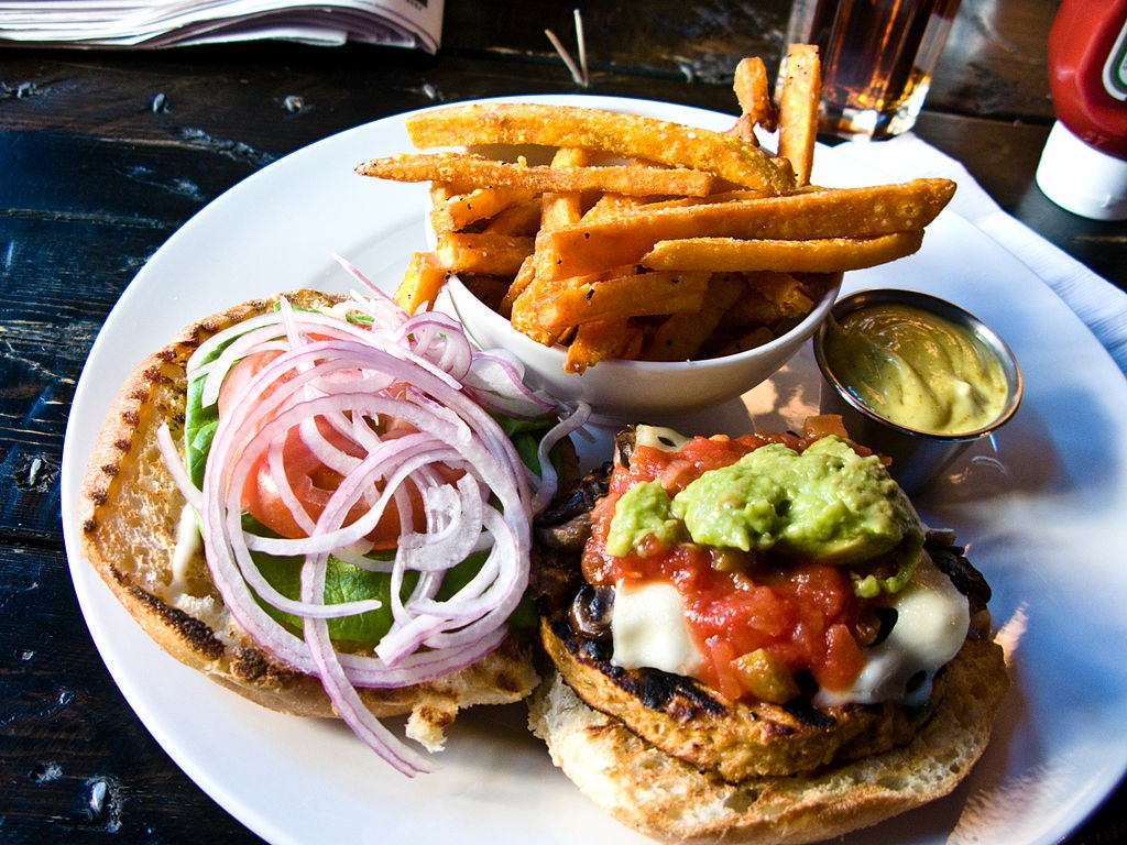 A veggie burger with fries.