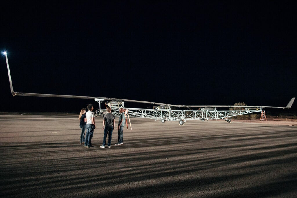 Mark Zuckerberg and others stand near Aquila, Facebook's internet drone.