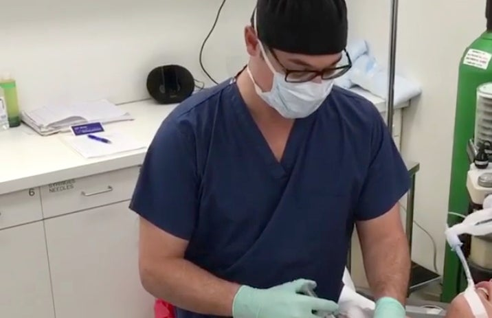 Screenshot from Buzzfeed Facebook Live video of skin-tightening surgery