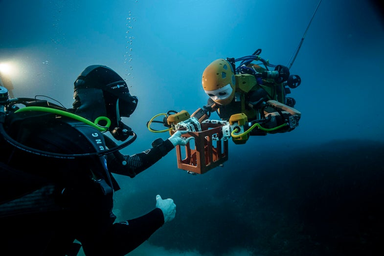 OceanOne and a human diver working together under water