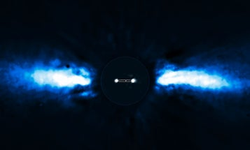 Astronomers Capture First Images of an Exoplanet Orbiting Its Star