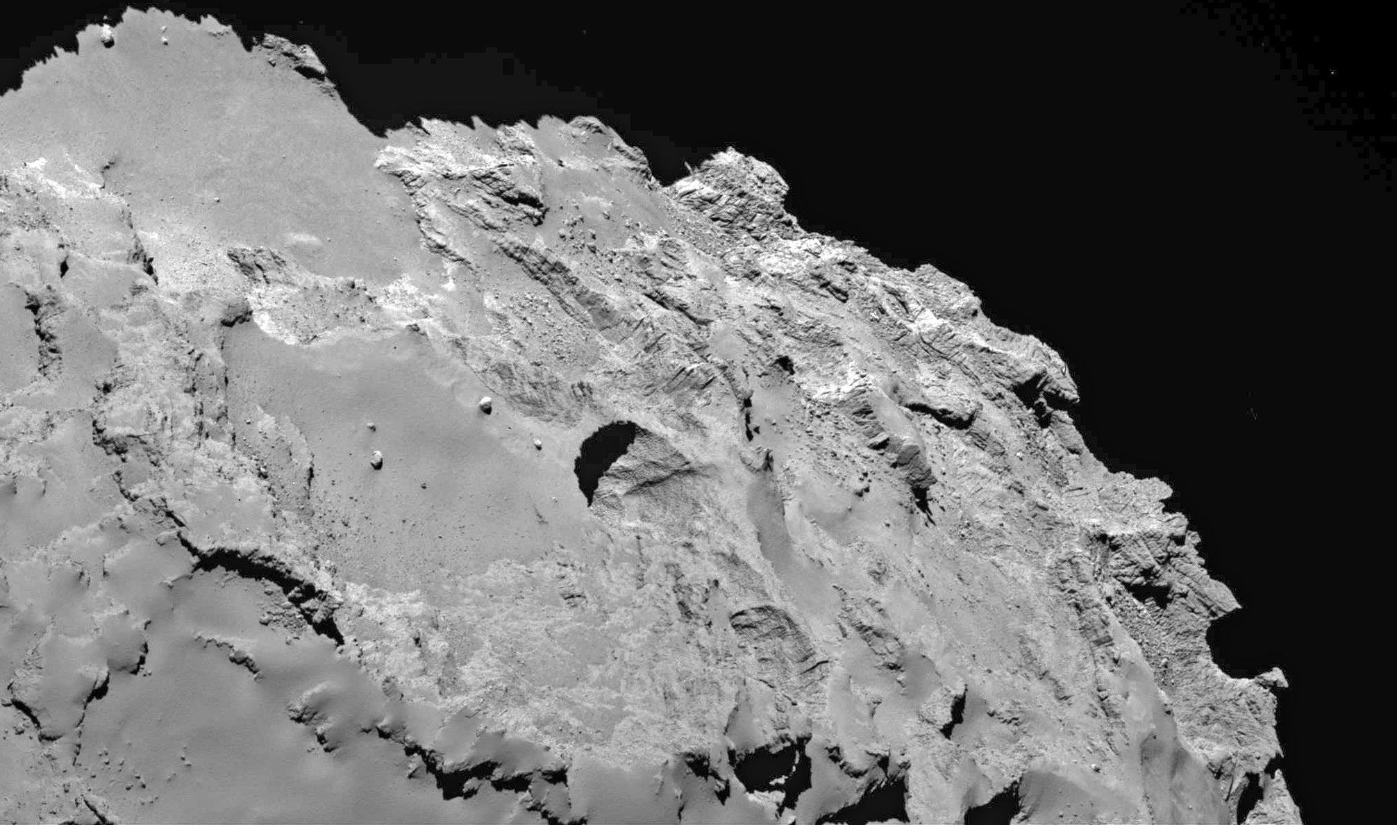Rosetta Orbiter Spots 18 Holes On Comet
