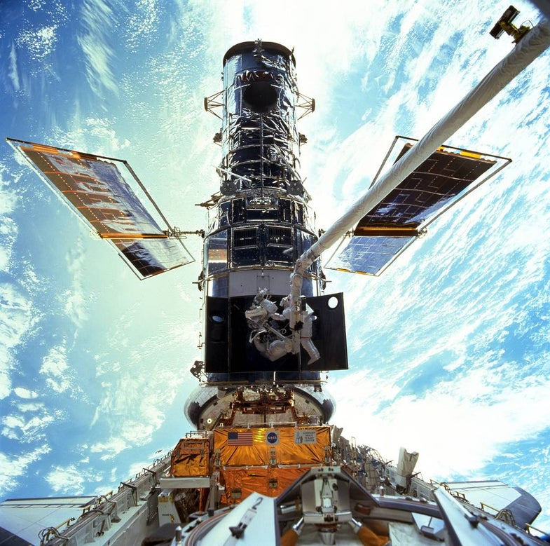 Discovery Docks with Hubble