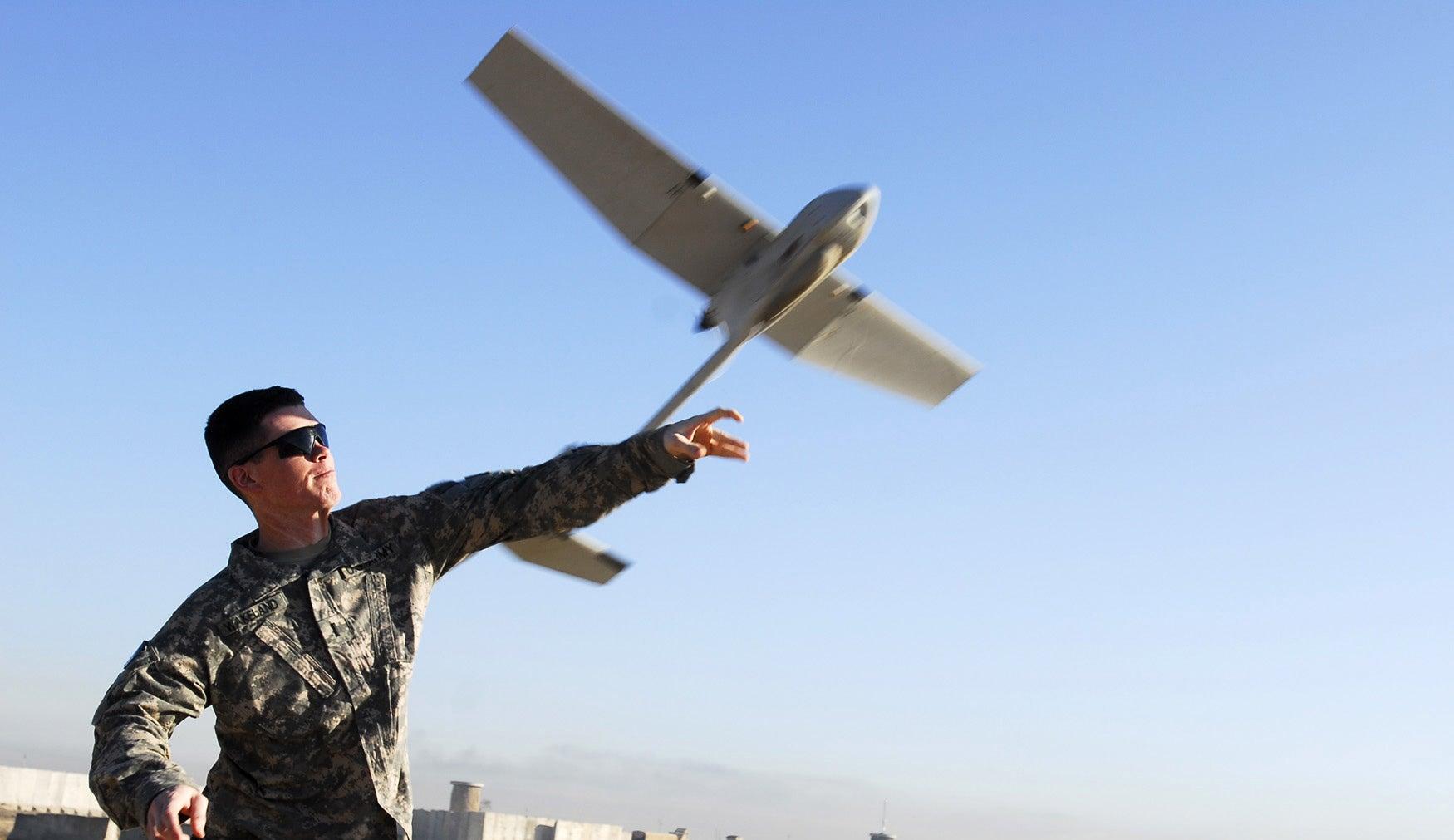 Solider In Iraq Tosses Raven UAV