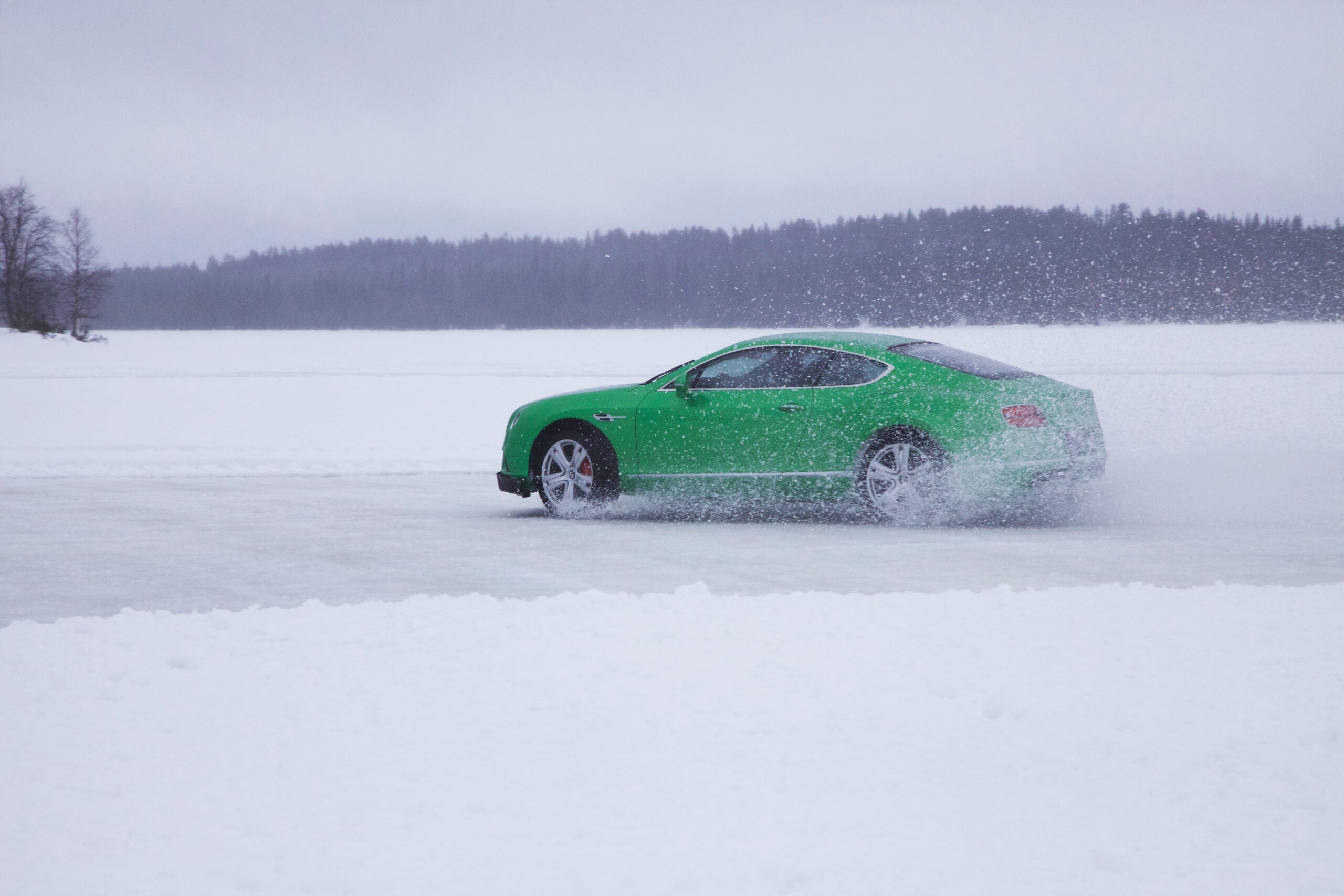 Drifting Luxury Cars Atop A Frozen Lake In Finland
