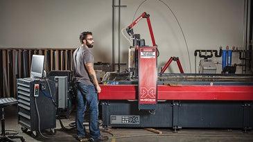 Justin Blair, a maker at FirstBuild, operates the Maxiem waterjet