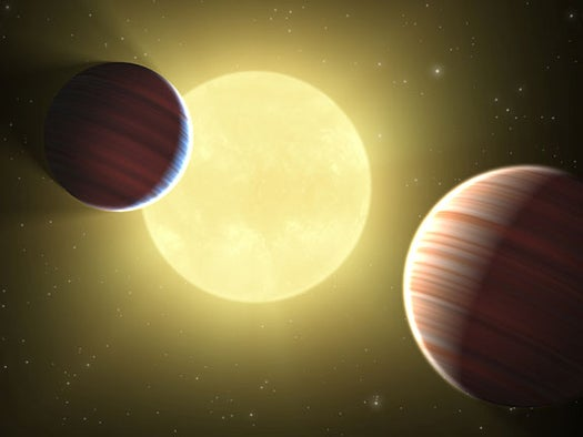 Two Planets Discovered Sharing the Same Orbit