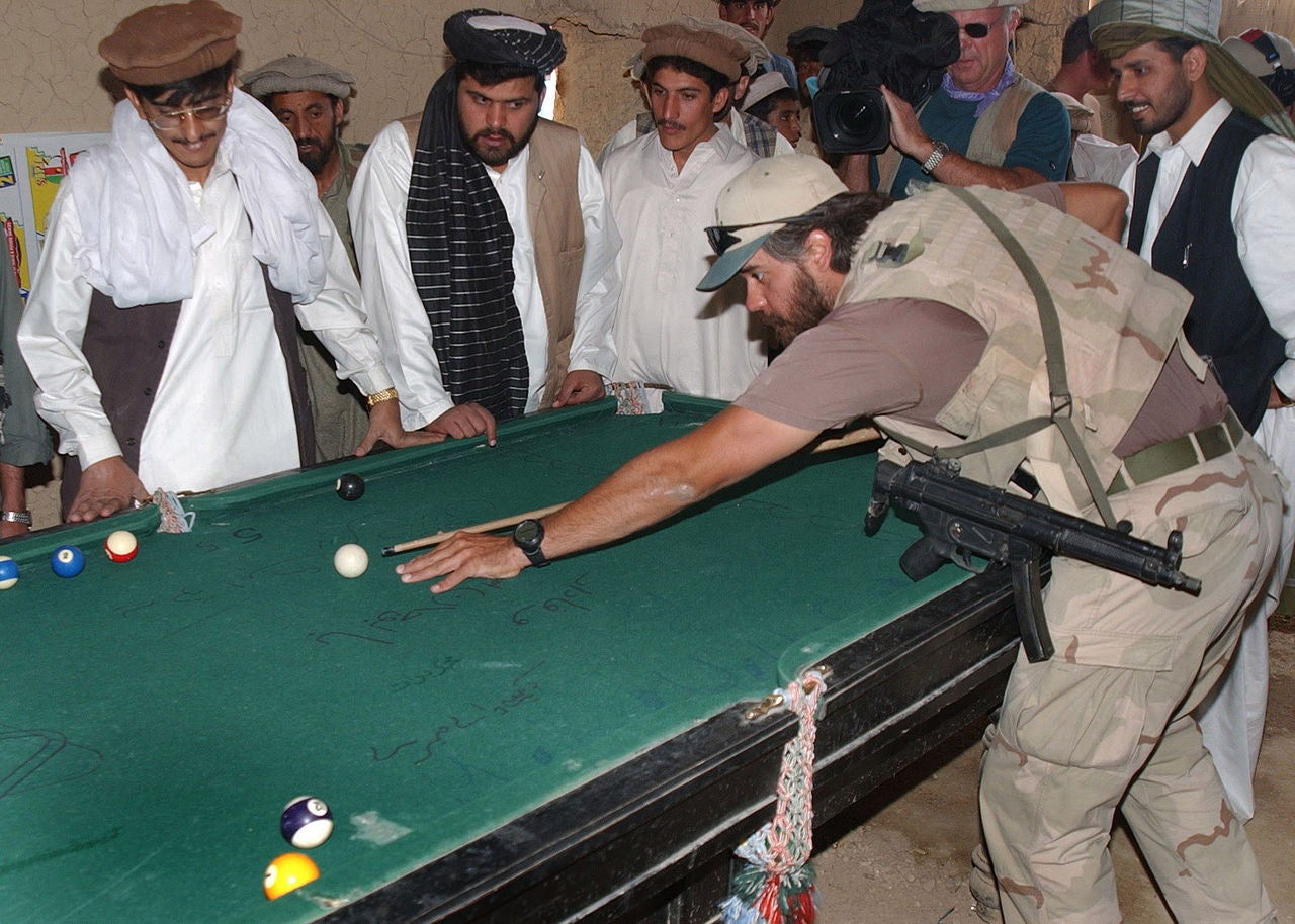 Special Forces Soldier Plays Pool In Afghanistan