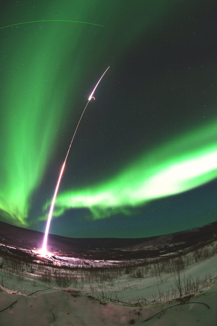 Pretty Space Pics: A Rocket Arcs Across the Northern Lights