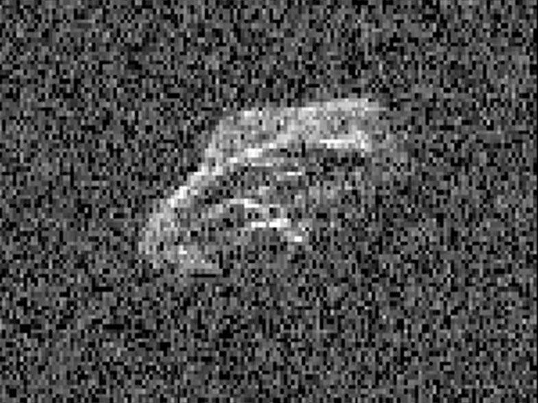 Watch A Weird-Shaped Asteroid Tumble Through Space [Video]