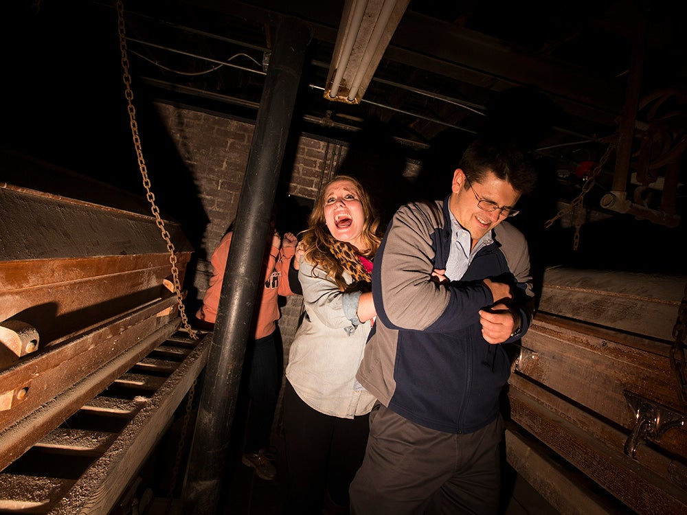 man and woman in haunted house