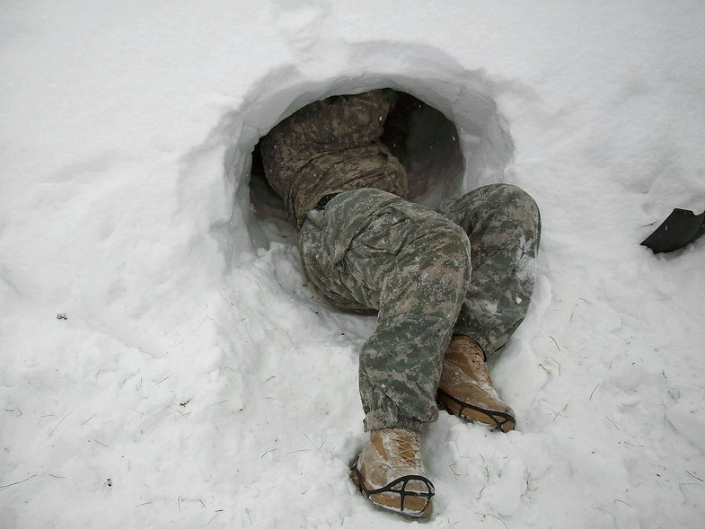 Soldier Making Snow Cave In Alaska